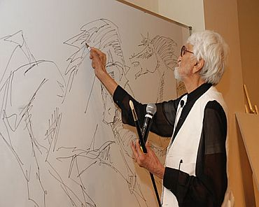 M F Husain at work.
