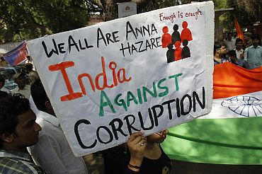 A supporter of social activist Anna Hazare holds up a sign during a campaign against corruption in New Delhi