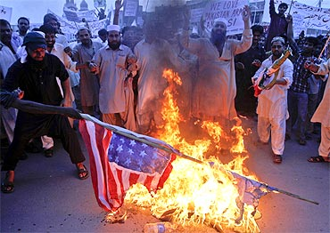 Activists burn national flags of the US, India and Israel in Multan