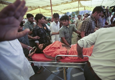 Ramdev is taken to a hospital on a stretcher by his supporters from his ashram
