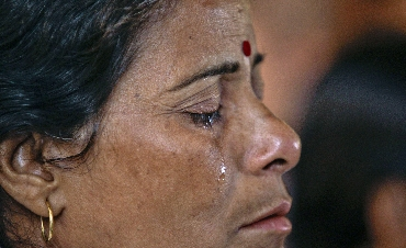 Tears roll down the face of a Ramdev supporter