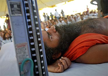 Ramdev, lying on stage, gets a medical check-up done during his fast against corruption