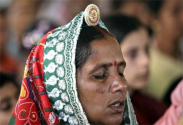 A Baba Ramdev supporter weeps on hearing news of his hospitalisation