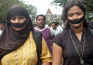 Journalists participate in a rally protesting the death of fellow jounalist Jyotirmoy Dey