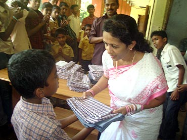 Dr Sunil distributes informs in schools