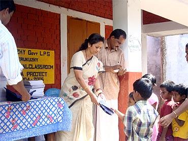 Dr Sunil distributes books among school children
