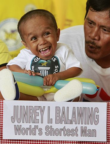 Reynaldo Balawing talks to his son Junrey in Sindangan, Zamboanga del Norte in southern Philippines