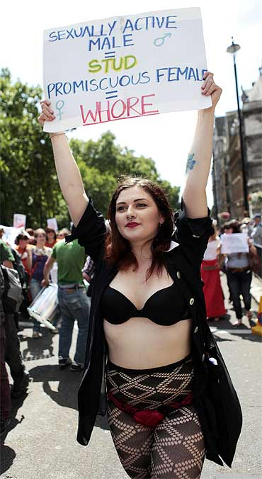 A SlutWalk participant carries a banner during a march from Hyde park Corner to Trafalgar Square