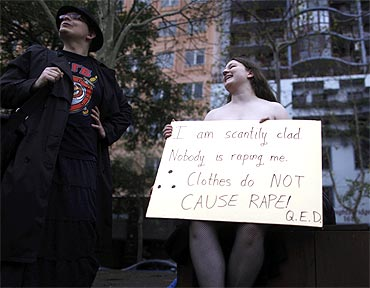 A protester holds a sign during a Slutwalk rally in Sydney