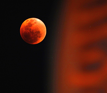 The moon is visible during a total lunar eclipse