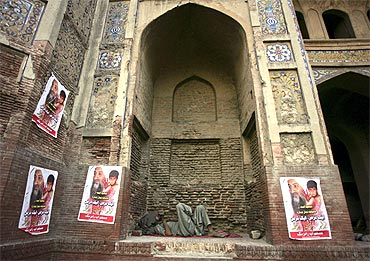 Posters of Osama bin Laden at the Chauburji monument in Lahore