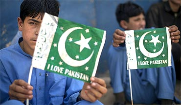 Schoolboys hold Pakistani flags
