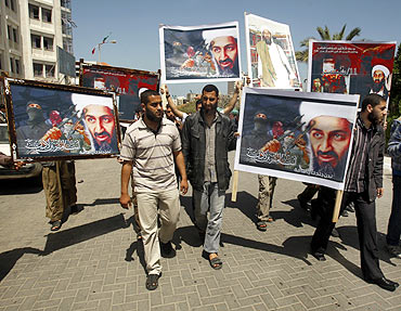 Palestinians, holding pictures depicting Osama bin Laden, protest in Gaza city