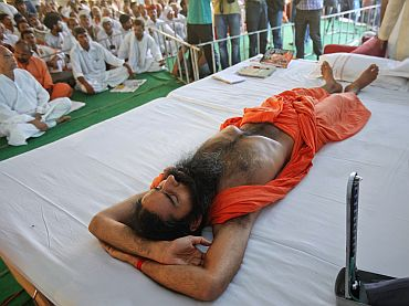 Yoga guru Baba Ramdev, lying on stage, gets a medical check-up during his fast against corruption in Haridwar
