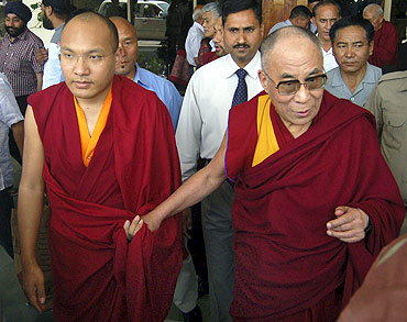 The Karmapa Lama with the Dalai Lama at the Kangra airport on the outskirts of Dharamsala on May 16, 2011