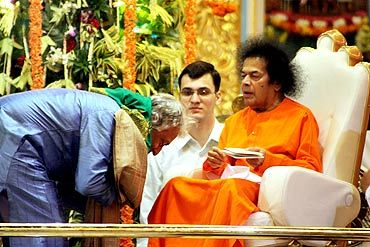 File photo of Ustad Amjad Ali Khan recieving blessings of Sathya Sai Baba