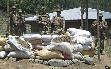 Soldiers stand near a checkpost which was attacked by militants in Upper Dir, along Pakistan's border with Afghanistan