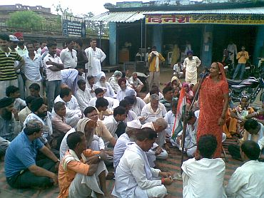 Fatima, and elderly villager, addresses a gathering to protest 'police atrocities' against Sonam