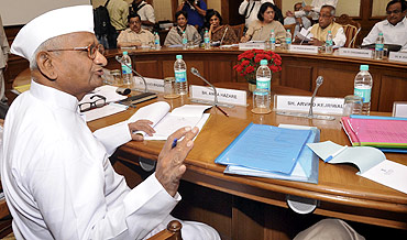 Social activist Anna Hazare speaks during a meeting with government representatives in New Delhi