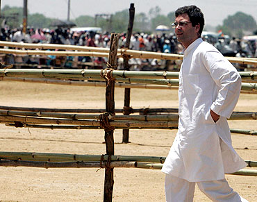 Rahul Gandhi walks towards his supporters during an election campaign rally in Purulia, WB