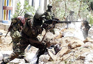 African Union Peacekeepers take up a defensive position as they battle insurgents in Mogadishu