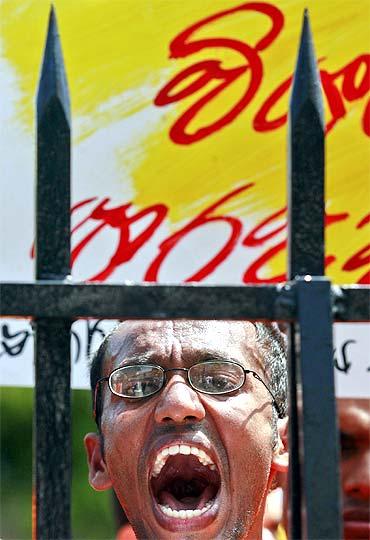 A student shouts slogans outside President Mahinda Rajapaksa's house