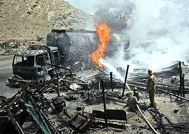 Firefighters hose down an oil tanker which was set ablaze by gunmen in Quetta June 19, 2011. Gunmen torched the truck carrying fu