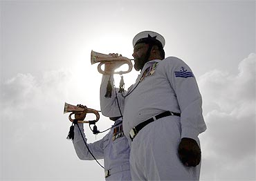 Sailors of Pakistan's Navy play bugles