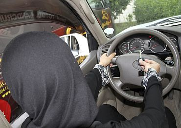 A Saudi woman poses in this picture to illustrate driving a car in Jeddah