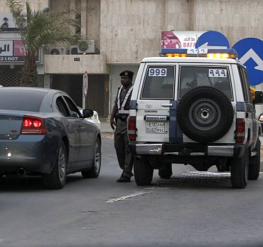 A vehicle stops at a Saudi traffic police checkpoint in Riyadh