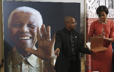Obama chats with Sello Hatang of the Nelson Mandela Foundation