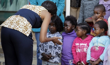 Michelle Obama meets children at the Emthonjeni Community Center in Zandspruit Township