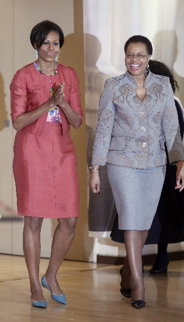 Michelle Obama walks with Nelson Mandela's wife Graca Machel as she visits the Nelson Mandela Foundation in Johannesburg