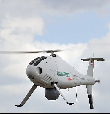 Schiebel's next-generation Camcopter UAV helicopter in flight. The Camcopter S-100 is a medium -range, medium endurance VTOL UAV system designed to provide a unique balance between advanced capabilities and operation in tactical environments