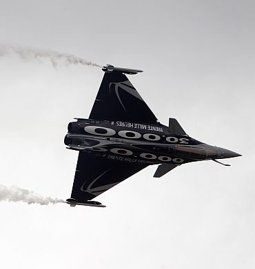 A Dassault Rafale fighter jet takes part in a flying display during the 49th Paris Air Show at the Le Bourget airport