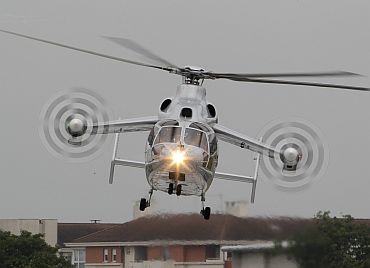 An Eurocopter X3 helicopter takes part in a flying display for French President Nicolas Sarkozy during the 49th Paris Air Show at the Le Bourget airport near Paris June 20