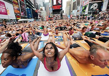 Munzin Chowdhury (C) and other enthusiasts perform yoga
