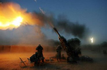 Soldiers from the US Army's Alpha Battery fire their 155 mm Howitzer in Cop Cherokee base in Logar province