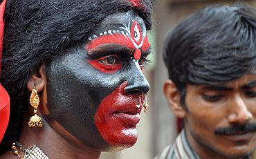 A devotee paints her face like Maa Kamakhya