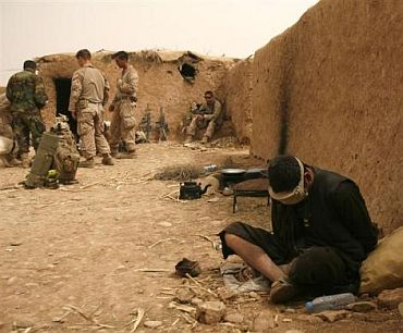An Afghan national, who is a possible suspect, is detained in one of the compounds US Marines hold, in Marjah district, Helmand province