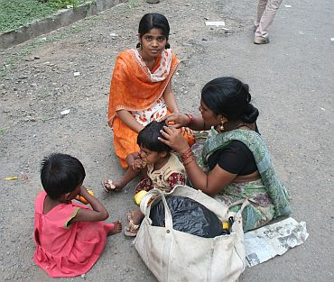 A mother with her three daughters at a health centre in Parli