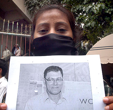 A journalist protests against J Dey's murder in Mumbai