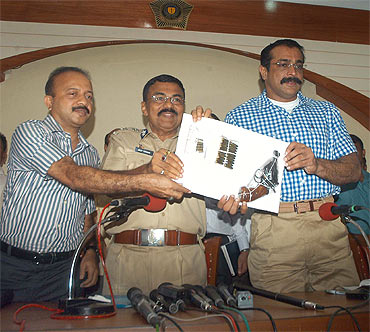 Mumbai Police Commissioner Arup Patnaik and Joint Commissioner of Police (Crime) Himanshu Roy address a press conference
