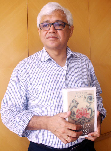 Amitav Ghosh with his latest book, River Of Smoke