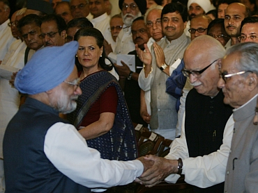 Dr Manmohan Singh meets BJP leader LK Advani as Congress President Sonia Gandhi looks on
