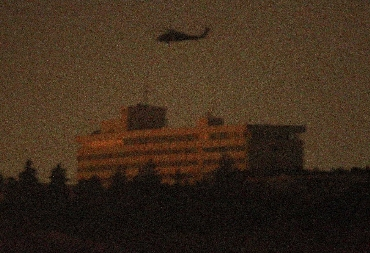 A NATO helicopter flies above the Intercontinental Hotel in Kabul