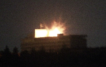 The roof of the Intercontinental hotel is lit up by an explosion during a battle between NATO-led forces and suicide bombers and Taliban insurgents in Kabul