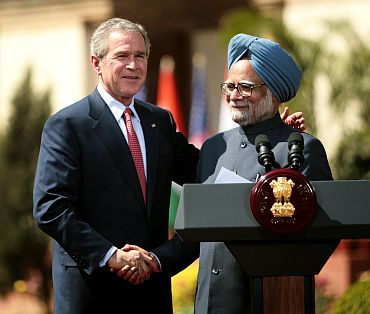 Former US President George W Bush shakes hands with PM Manmohan Singh after India and the United States sealed a civilian nuclear cooperation pact, in New Delhi