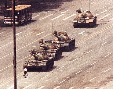 A Beijing man stands in front of tank in Tianeman Square