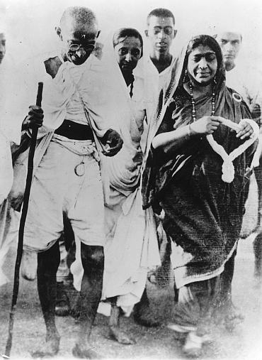 Poet and politician Sarojini Naidu with Mahatma Gandhi during the Salt March